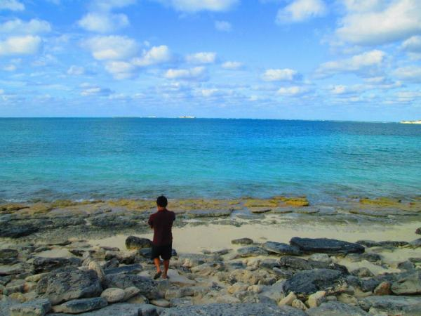 We went on the beach everyday while we were in the Bahamas. I love this picture because you can see how colorful the sky, ocean, sand, and rocks are. This is me just walking around the beach