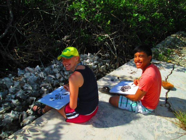 A lot of times we would go out in the island to do art. Siri McCord '15 and I are pictured here doing a negative space, a medium that we learned from the class, of the mangroves in front of us