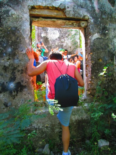 We visited many of the ruins on Sal Salvador, Bahamas. Many of the ruins are old slave plantations. This picture shows me going through one of the windows of what use to be a home. You can see that some of the wood on top the window is still there